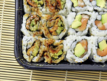 Tightly packed sushi rolls on platter Stock Photography