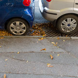 Tightly parked cars on the street Stock Photography