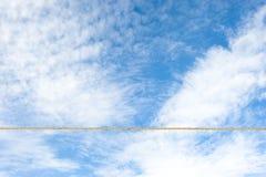 Tightrope across sky Stock Image