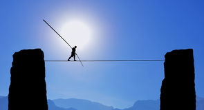 Tightrope Walker Balancing on the Rope Royalty Free Stock Images