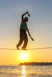 Tightrope walker performing Stock Image
