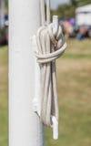Tightrope on the white iron pole. Stock Photos