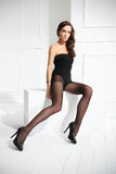 Tights. Beautiful, leggy woman in thin tights and fashionable styling Stock Photos