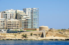 Tigne Point with Fort Tigne  in Sliema, Malta. Tigne Point with Fort Tigne with its circular keep, built by the Order of Saint John, one of the oldest polygonal Stock Photo