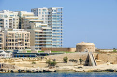 Tigne Point with Fort Tigne  in Sliema, Malta. Tigne Point with Fort Tigne with its circular keep, built by the Order of Saint John, one of the oldest polygonal Stock Photos