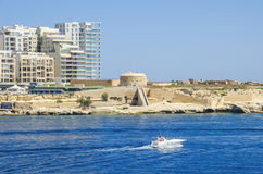 Tigne Point with Fort Tigne  in Sliema, Malta. Tigne Point with Fort Tigne with its circular keep, built by the Order of Saint John, one of the oldest polygonal Royalty Free Stock Photography