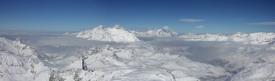 Tignes Panorama. Tignes France, Standing at the Summit of the Grande Casse overlooking Tignes towards Switzerland with Mont Blanc peering through the clouds Royalty Free Stock Photos