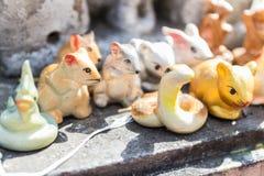 Tigre, serpiente, rata, estatuilla del conejo Fotografía de archivo