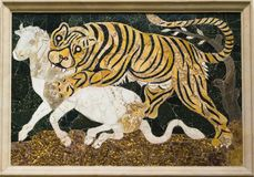 Tigress attacing a calf. Multicolor marbles. 4th century A.D. Rome, equilin hill, Basilika of Julius Basus Stock Photography