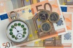 Tijd en geld Stock Afbeelding