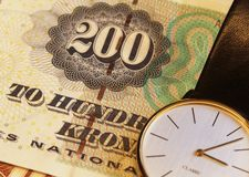 Tijd en geld Stock Foto's