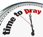 Tijd te bidden - Klok Royalty-vrije Stock Foto's