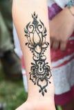 Tijdelijke tatoegering in henna, stock afbeelding