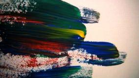 Tijdtijdspanne van multi gekleurde borstelslagen op canvas stock footage