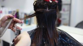Tijeras del pelo del corte del peluquero, peine metrajes