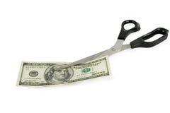 Tijeras que cortan 100 dólares Imagen de archivo libre de regalías