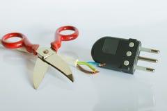 Tijeras y enchufe eléctricos Fotografía de archivo libre de regalías