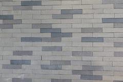 Tijolo cinzento da cor no fundo da parede Fotos de Stock