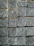 Tijolo de pedra Parede de tijolo da textura, telhas cinzentas brickly do close-up Fundo da textura da pedra da rua foto de stock royalty free
