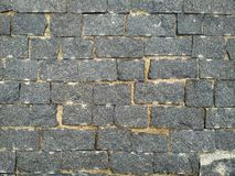 Tijolo de pedra Parede de tijolo da textura, telhas cinzentas brickly do close-up Fundo da textura da pedra da rua imagens de stock royalty free