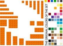 Tijolos plásticos da construção com muitas cores a escolher de Imagens de Stock Royalty Free