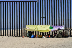 Tijuana border. TIJUANA, BC, MEXICO - JULY 28, 2012 - Picnickers protect themselves from the summer sun by attaching sheets to the new US - Mexico border fence Stock Photography