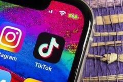 Free Tik Tok Application Icon On Apple IPhone X Screen Close-up. Tik Tok Icon. Tik Tok Application. Tiktok Social Media Network. Socia Stock Photos - 140770183