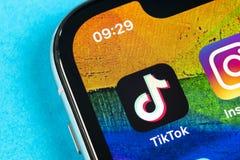 Free Tik Tok Application Icon On Apple IPhone X Screen Close-up. Tik Tok Icon. Tik Tok Application. Tiktok Social Media Network. Social Stock Photo - 149374130