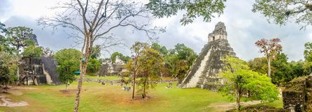 Panoramic view at the Tikal Temple I and Temple II from Nord Acropolis in Tikal Natinal Park - Guatemala stock image