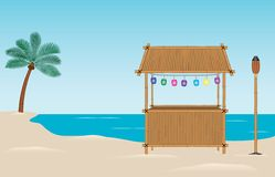 Tiki Bar on the Beach. A bamboo tiki bar on the beach. Paper lanterns hang above the bar. There is also a bamboo tiki torch and a palm tree in the background Royalty Free Stock Image