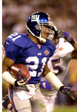 Tiki Barber in SB XXXV. New York Giants RB Tiki Barber runs the ball against the Baltimore Ravens defense in Super Bowl XXXV. (Image taken from color slide Stock Photos