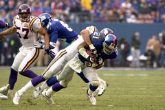 Tiki Barber. Is tackled by a Minnesota Vikings defender Royalty Free Stock Image