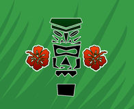 Tiki God with Hibiscus Royalty Free Stock Image