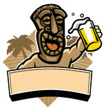 Tiki hold a glass of beer Stock Image
