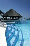 Tiki hut and bar by swimming pool of luxury hotel Stock Images