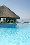 Tiki hut and bar by swimming pool of luxury hotel Royalty Free Stock Photo