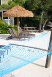 Tiki Hut and hammock Stock Photo