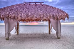 Tiki hut shelter on Tigertail Beach on Marco Island, Florida. At sunset stock images
