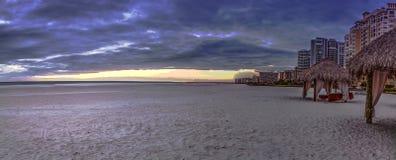 Tiki hut shelter on Tigertail Beach on Marco Island, Florida. At sunset royalty free stock image