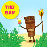 Tiki with legs. Happy tiki welcoming guests with cocktail in his hand Royalty Free Stock Image