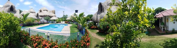 Tiki paradise. Tiki hut pool flowers paradise Colombia vacation Royalty Free Stock Photo