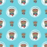 Tiki seamless pattern Polynesian masks tics on a blue background. Vector seamless pattern. Tiki seamless pattern Polynesian masks tics on a blue background Royalty Free Stock Photography