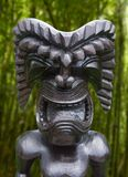 Tiki statue in topical jungle stock photos