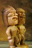 Tiki statues. Two tiki statues with gold reflections Royalty Free Stock Photos