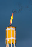 Tiki torch. Tiki mosquito repellent torch at an outdoor bbq Stock Photo