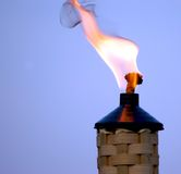 Tiki torch. At dusk during an outdoor party royalty free stock photos