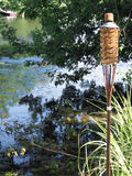 Tiki Torch on the Lake Royalty Free Stock Photos