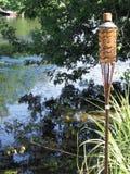 Tiki Torch on the Lake Royalty Free Stock Photos