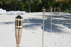 Tiki torches on the beach Stock Images