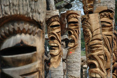 Tikis. Group of carved tiki statues stock photography
